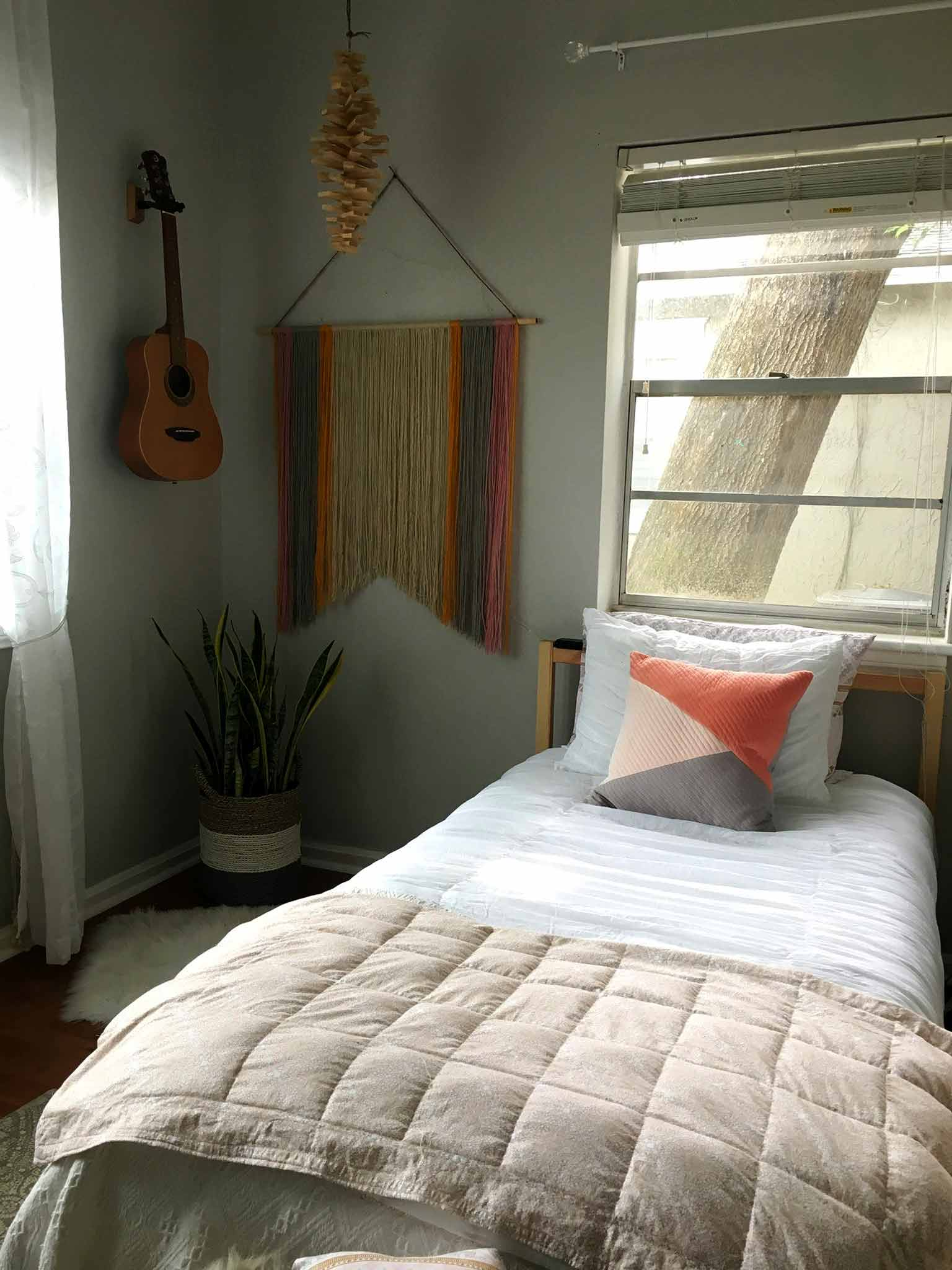 White bedding with a weighted blanket - modern boho tween bedroom - That Homebird Life Blog