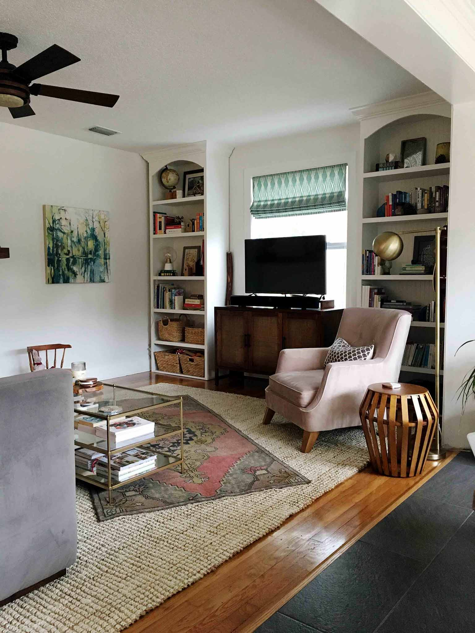 Living room with layered rugs - That Homebird Life Blog