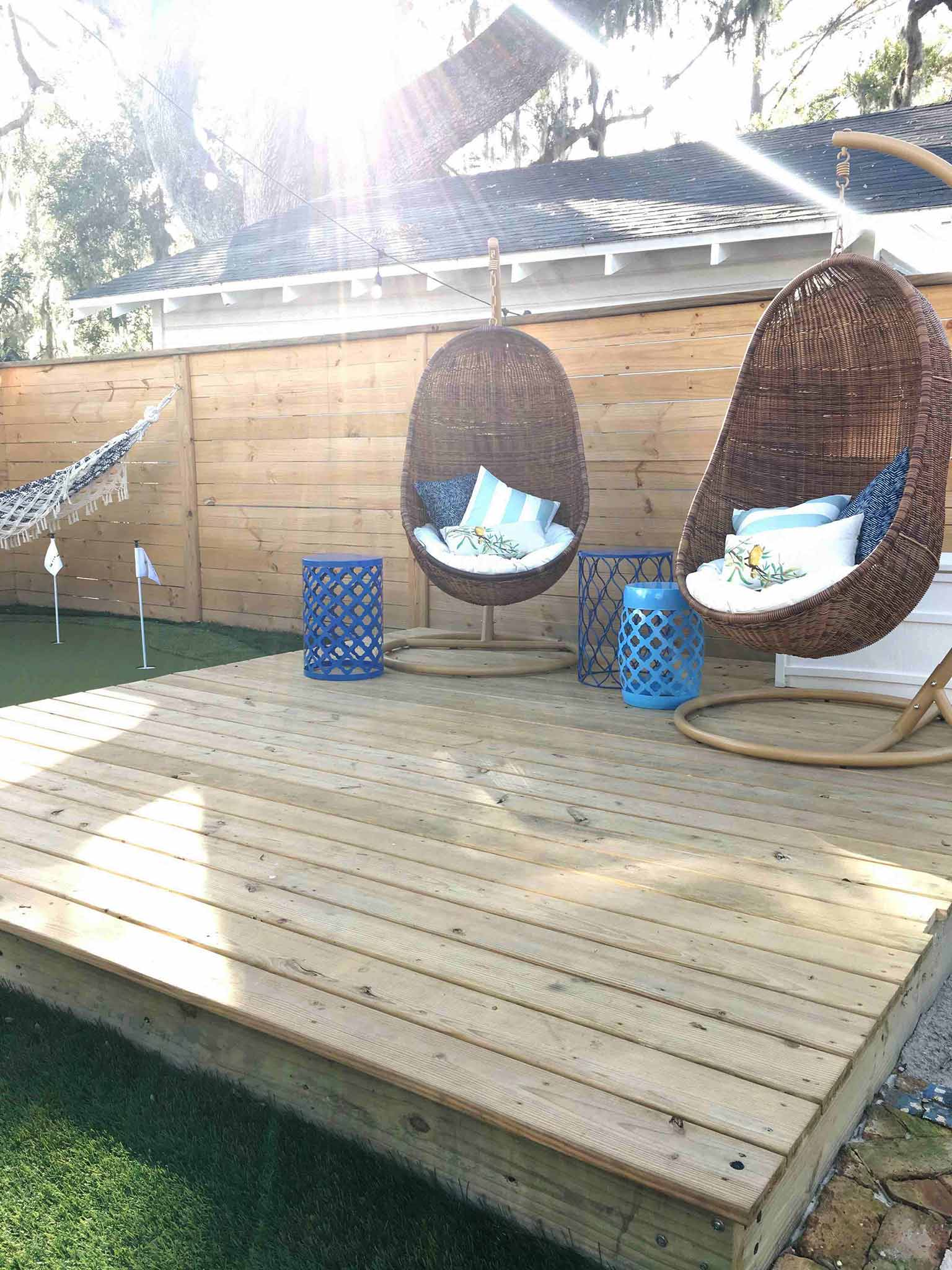 Seating area with hanging chairs - How we planned our backyard space - That Homebird Life Blog