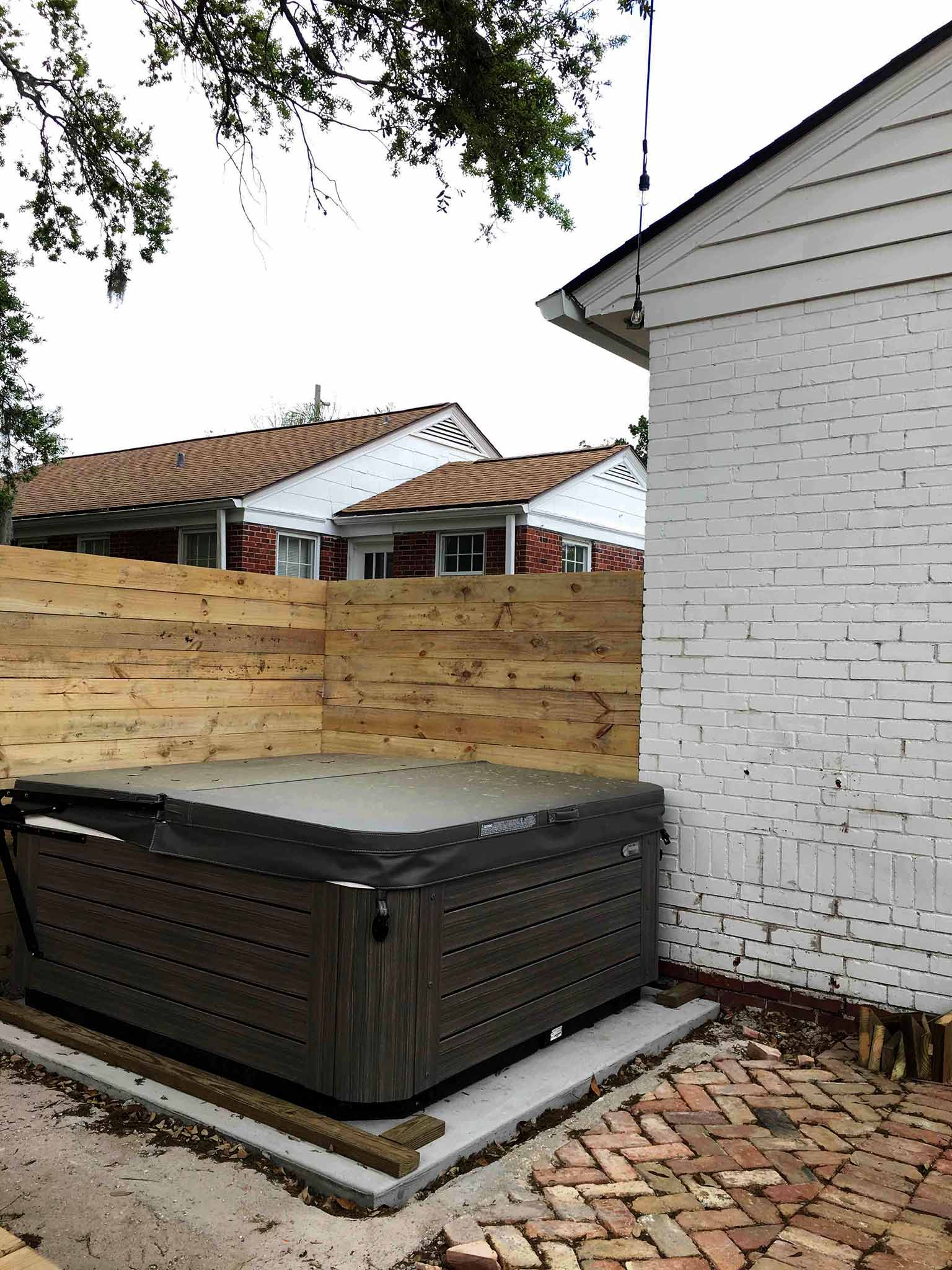 Backyard in progress - hot tub installation - That Homebird Life Blog