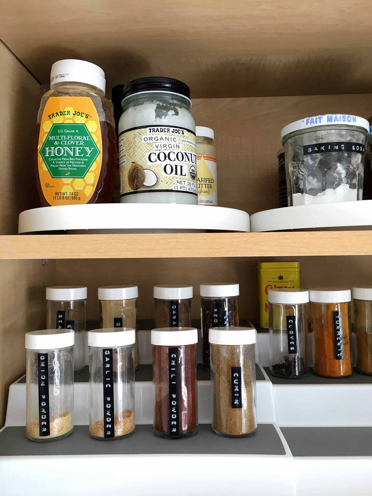 Organized kitchen cabinet with tiered spice rack - That Homebird Life Blog