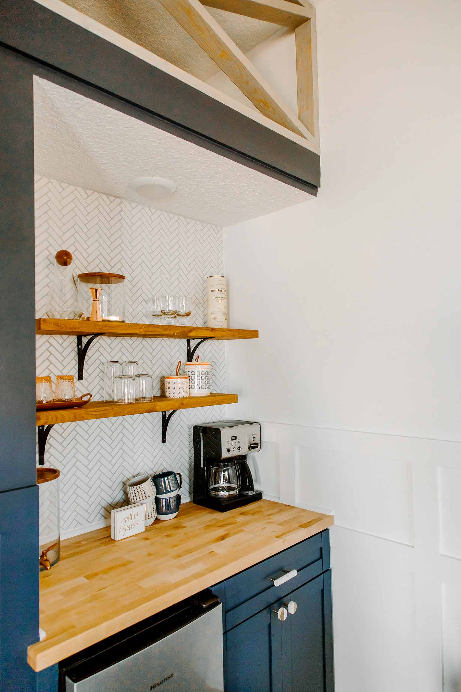 Kitchenette with hale navy cabinets, open shelving and herringbone tile - The Guest House Reveal - That Homebird Life Blog