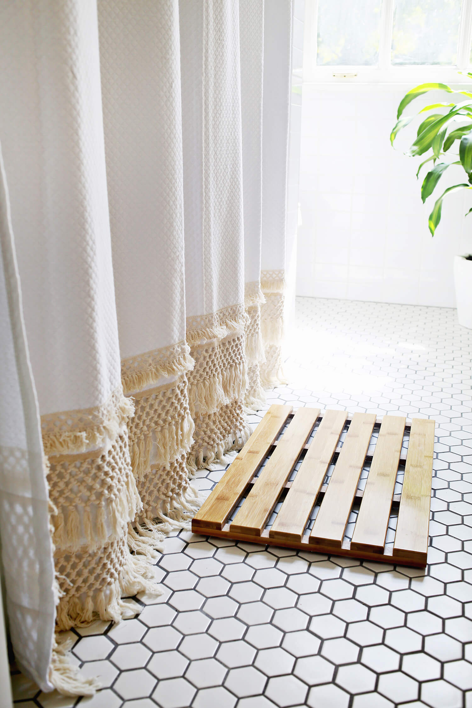 Macrame shower curtain - simple ways to style a bathroom - That Homebird Life Blog
