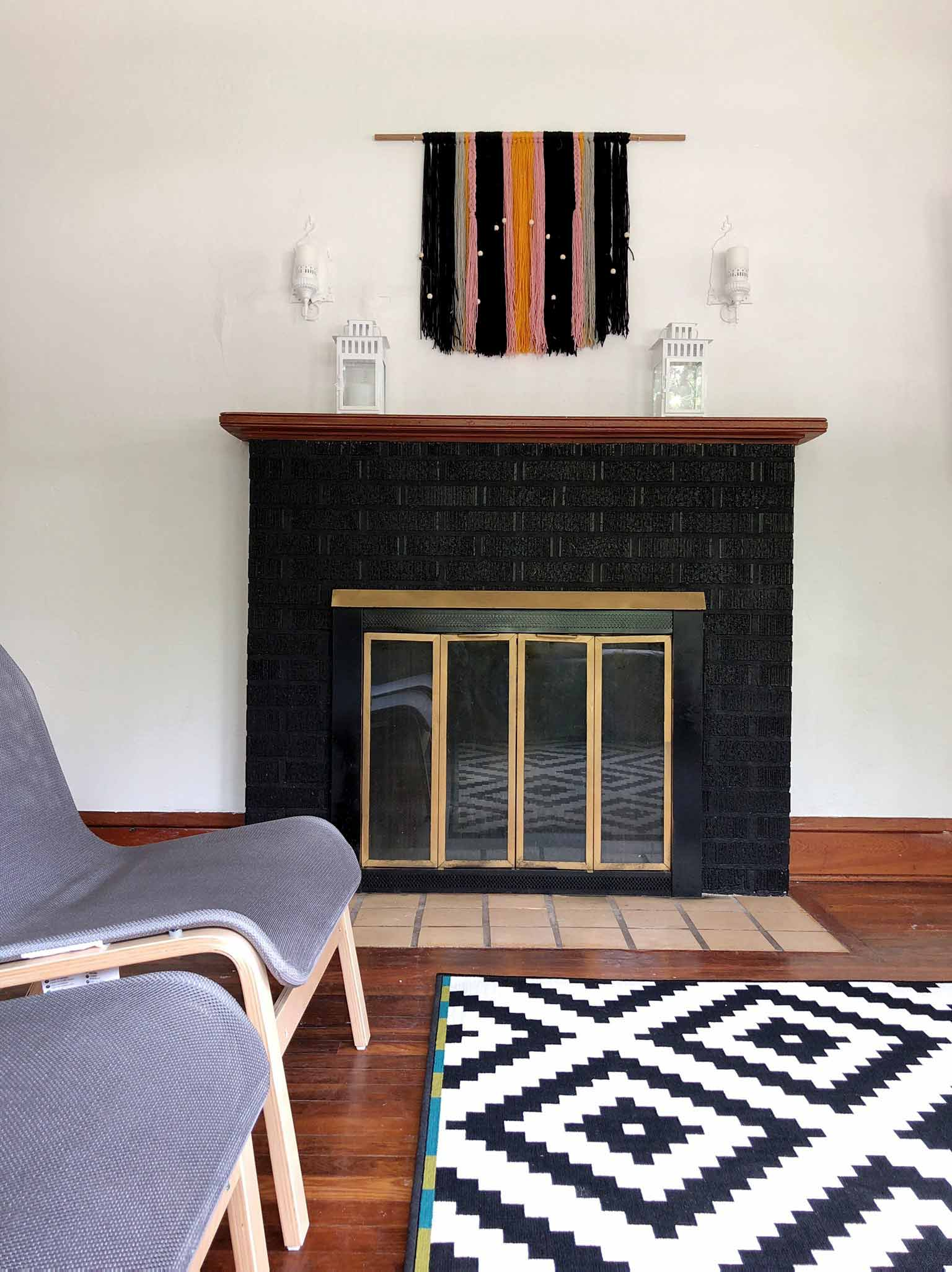 Painted brick fireplace - Modern minimalist room makeover on a budget - That Homebird Life Blog