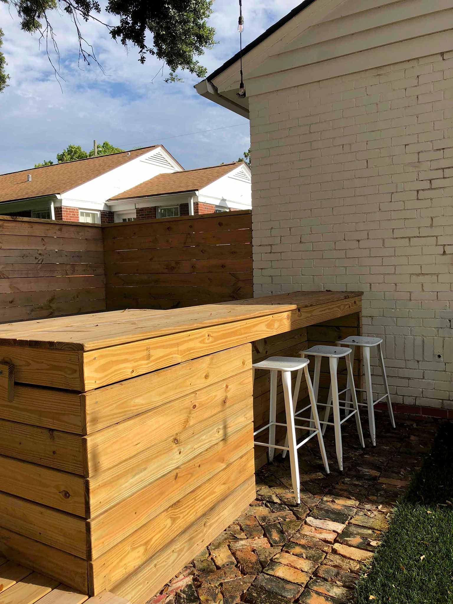 Our backyard in progress - bar and deck surrounding hot tub - That Homebird Life Blog
