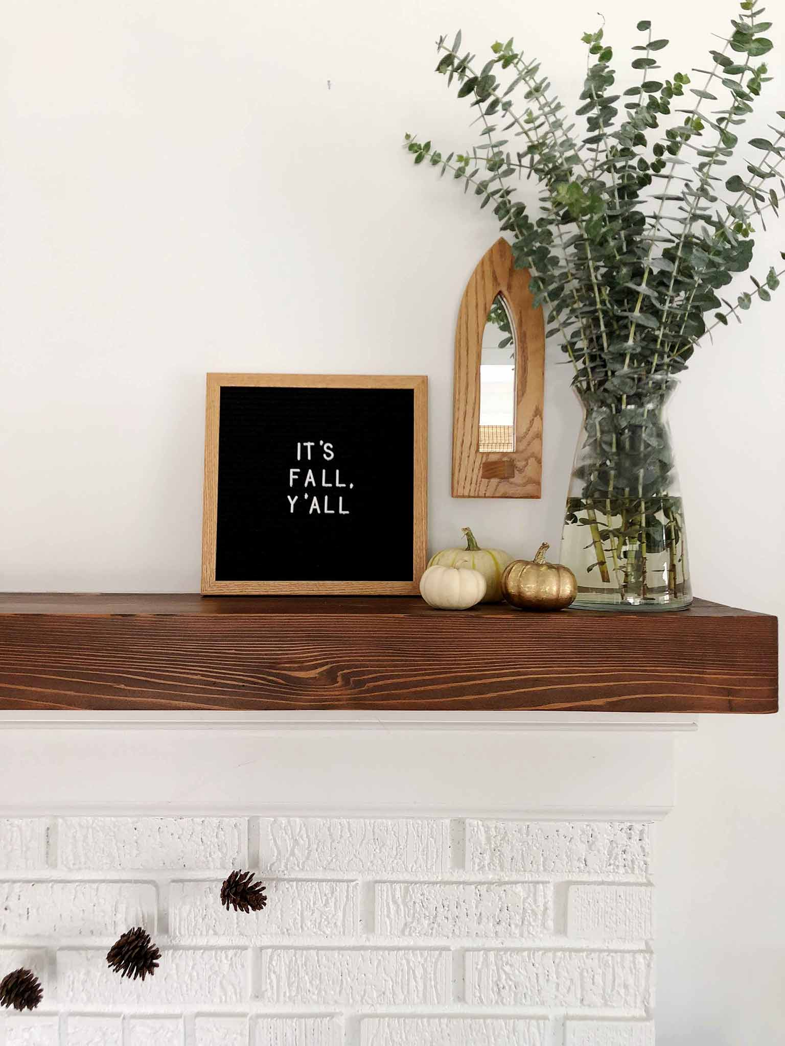 Fall mantel using pinecones, pumpkins, a letterboard and eucalyptus - Simple Fall Decor for the Uncluttered Home - That Homebird Life blog