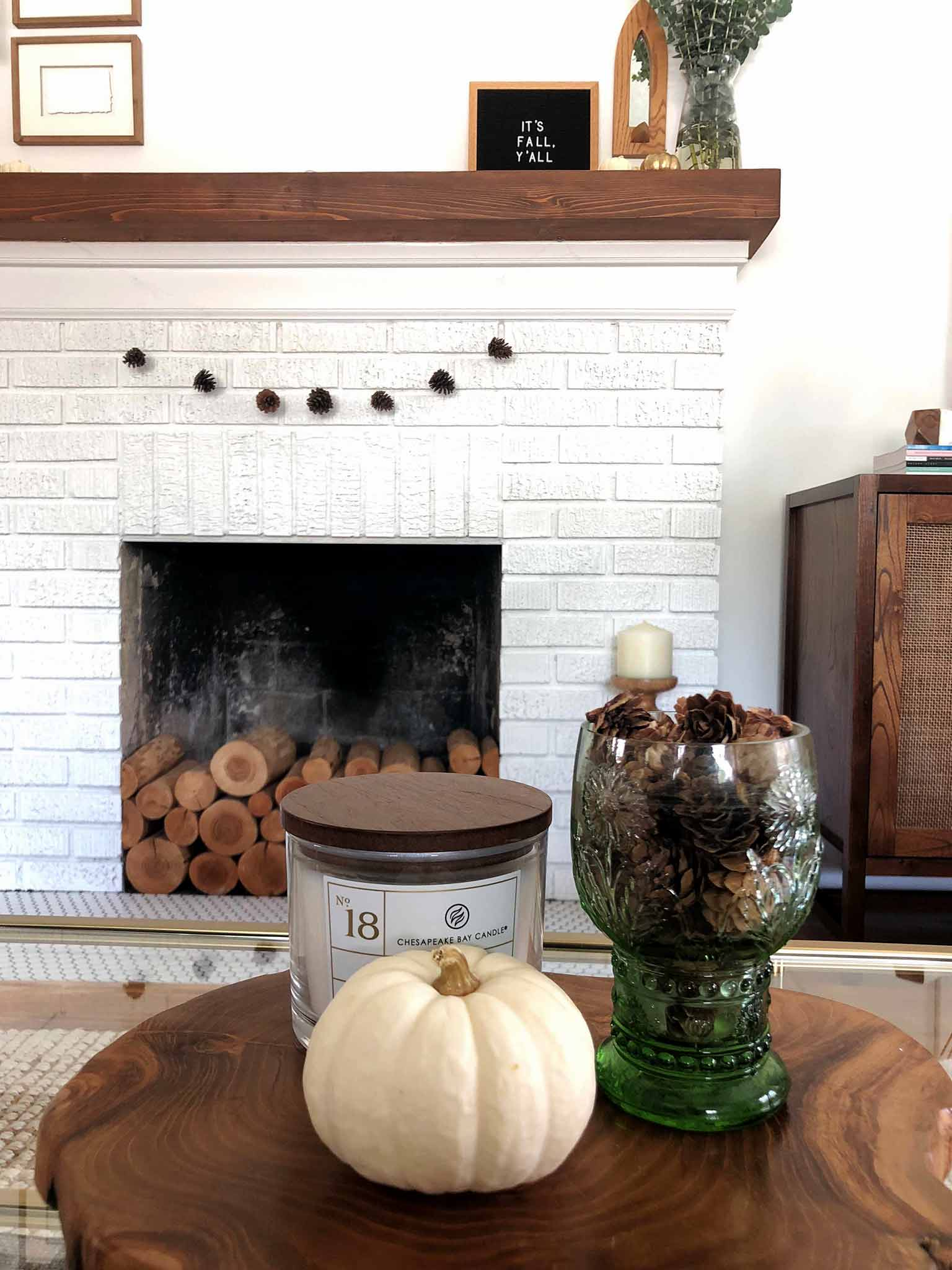Fall mantel using pinecones and pumpkins - Simple Fall Decor for the Uncluttered Home - That Homebird Life blog
