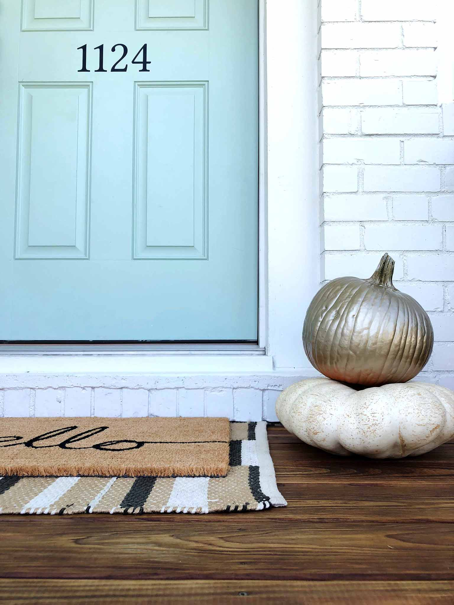 Stacked pumpkins with gold spray paint - Front porch fall makeover reveal - That Homebird Life Blog
