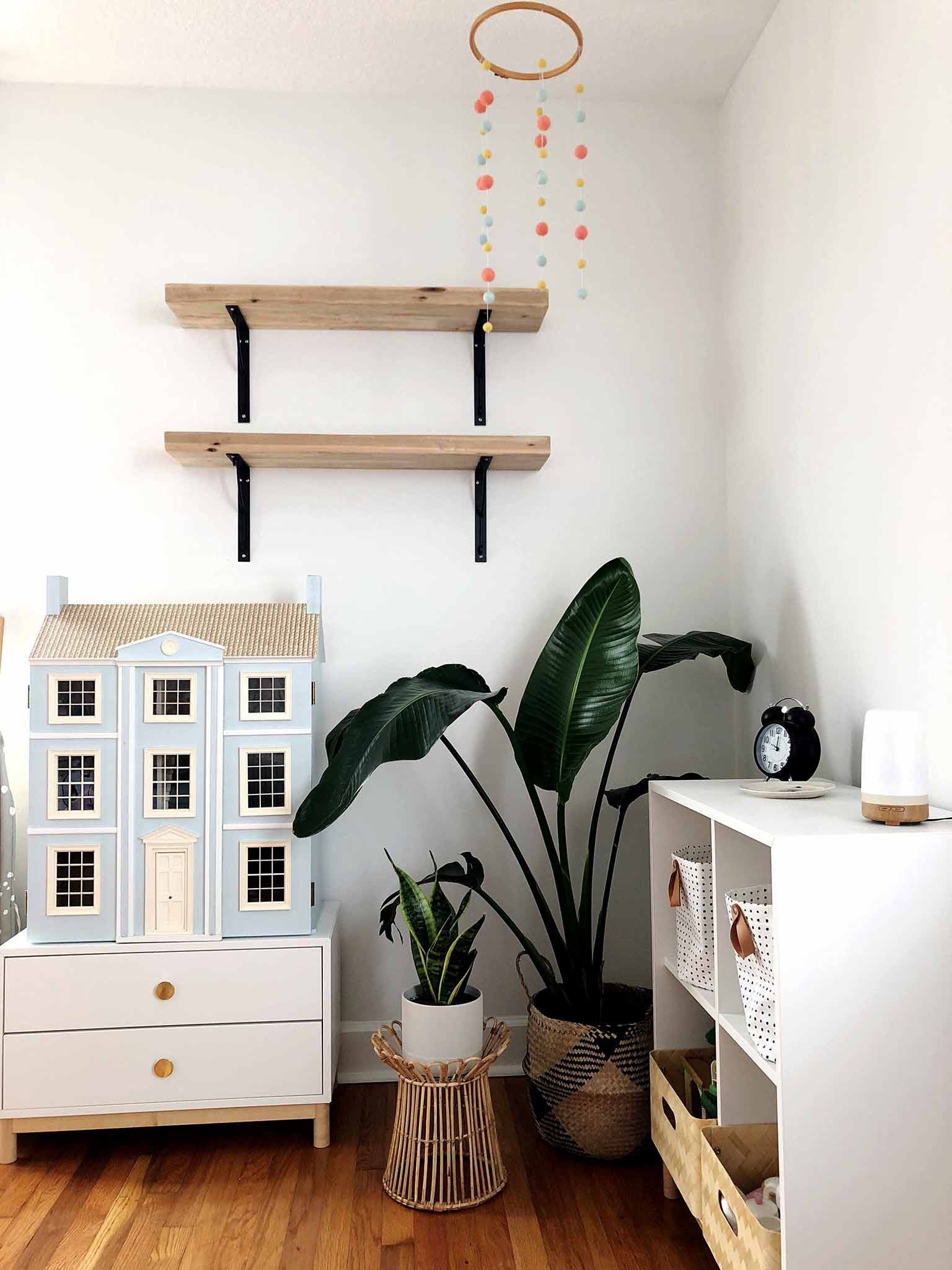 Corner of girls bedroom with wall shelves, plants, doll house and IKEA EKET storage - Guest Participant of the One Room Challenge - That Homebird Life Blog