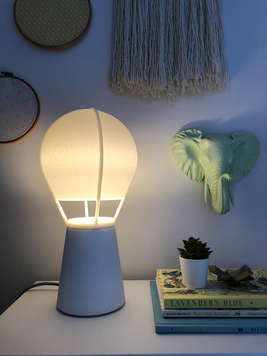 corner of girls bedroom with gantri table lamp