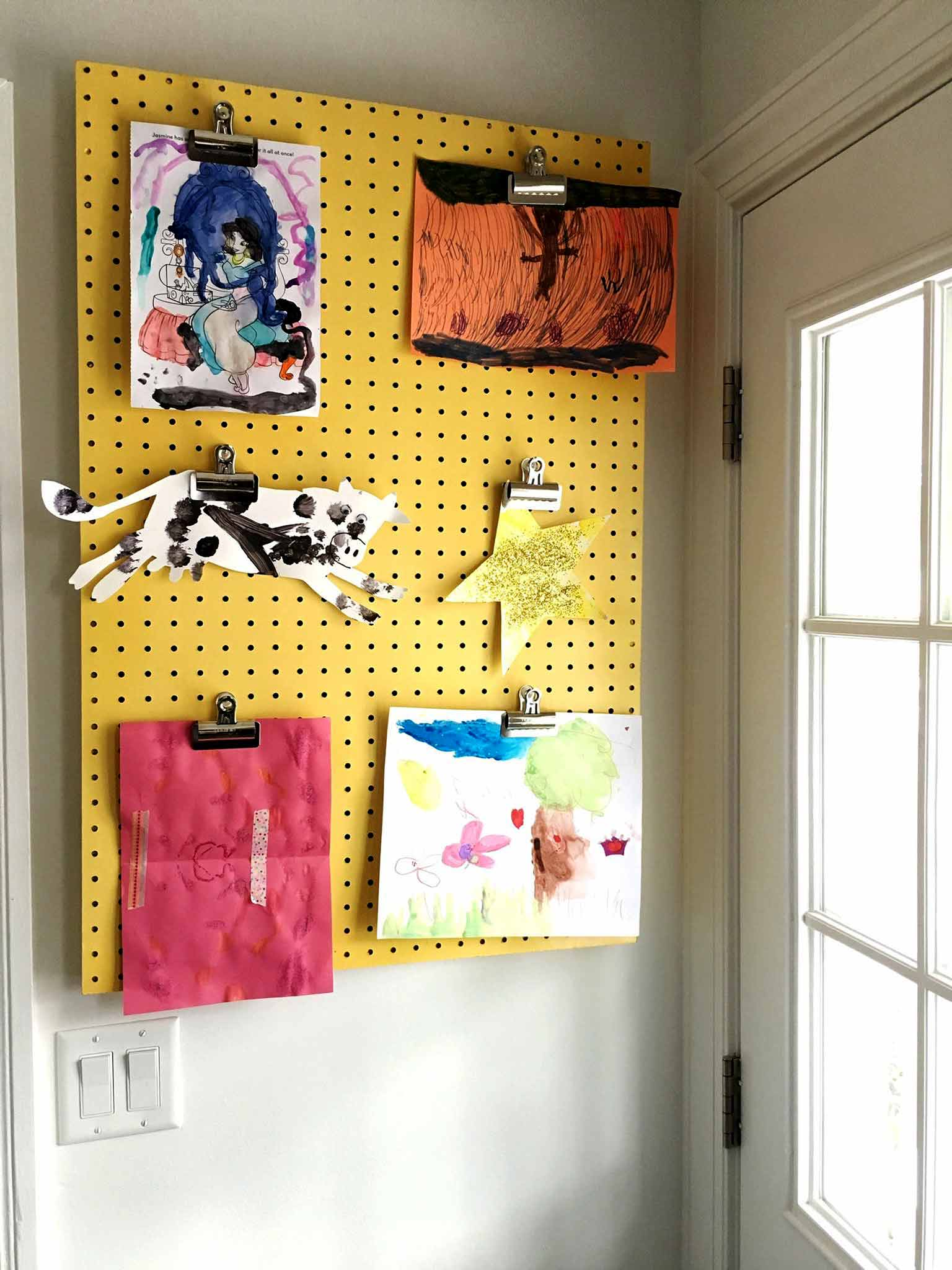 Old Pegboard Display Board for Kids Artwork - Covering up an electrical panel - That Homebird Life Blog