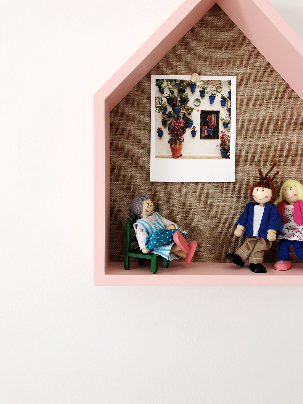 cubby with doll house figures