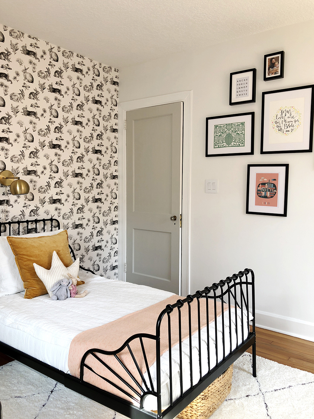 gallery wall and twin bed