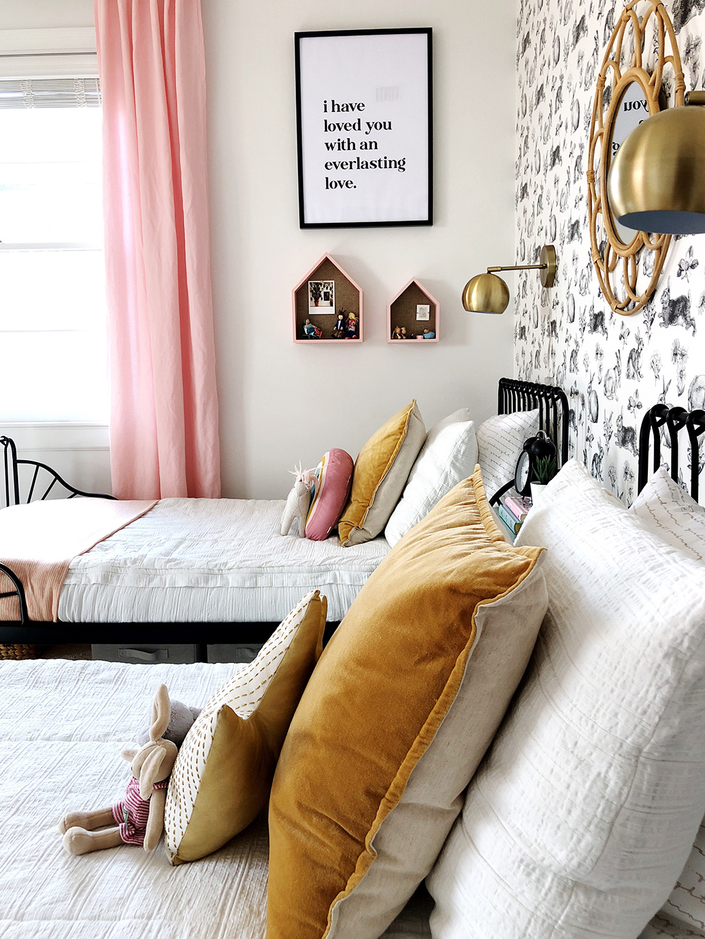 twin beds with rabbit wallpaper