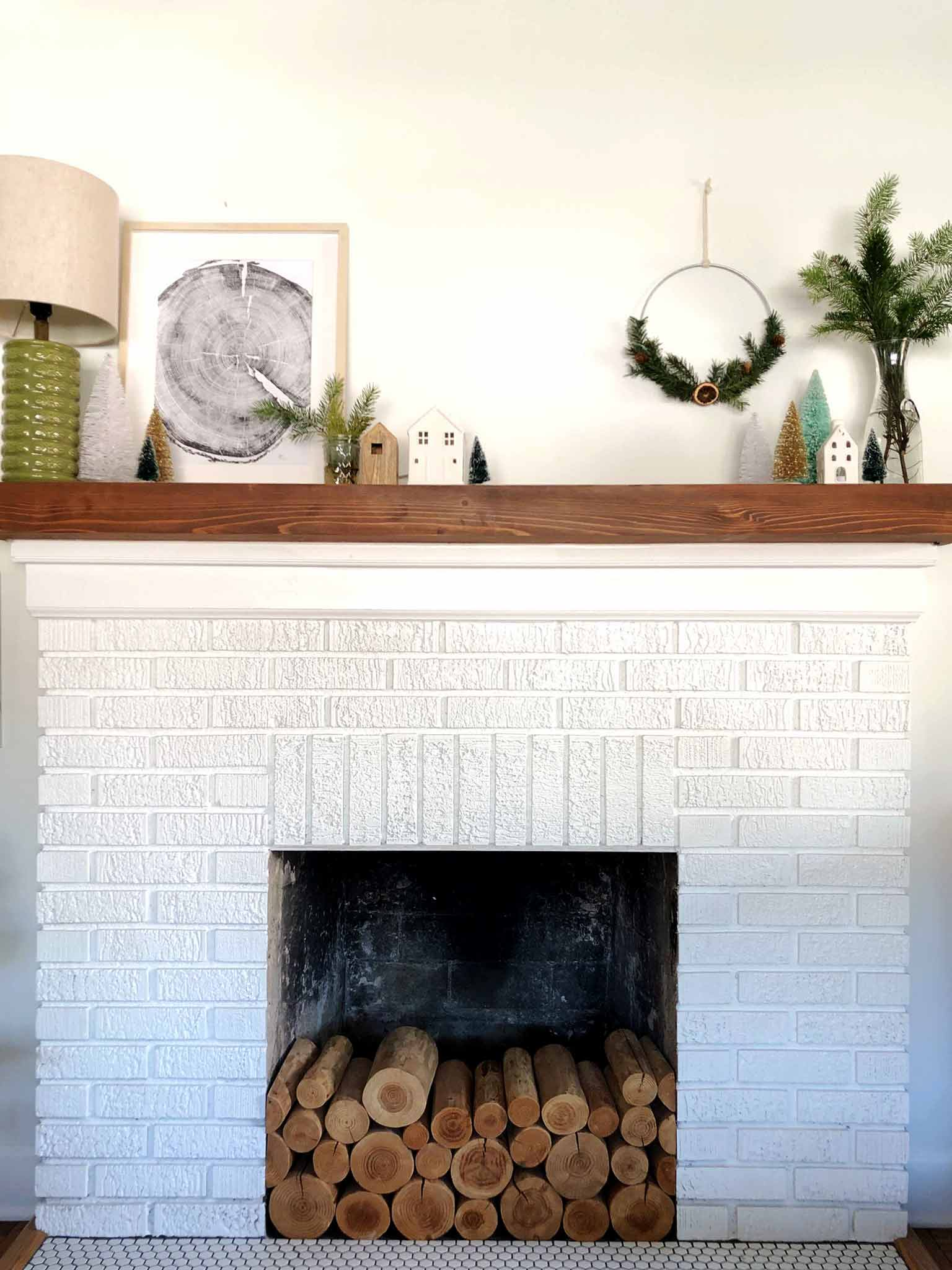 painted white brick fireplace with wood mantel