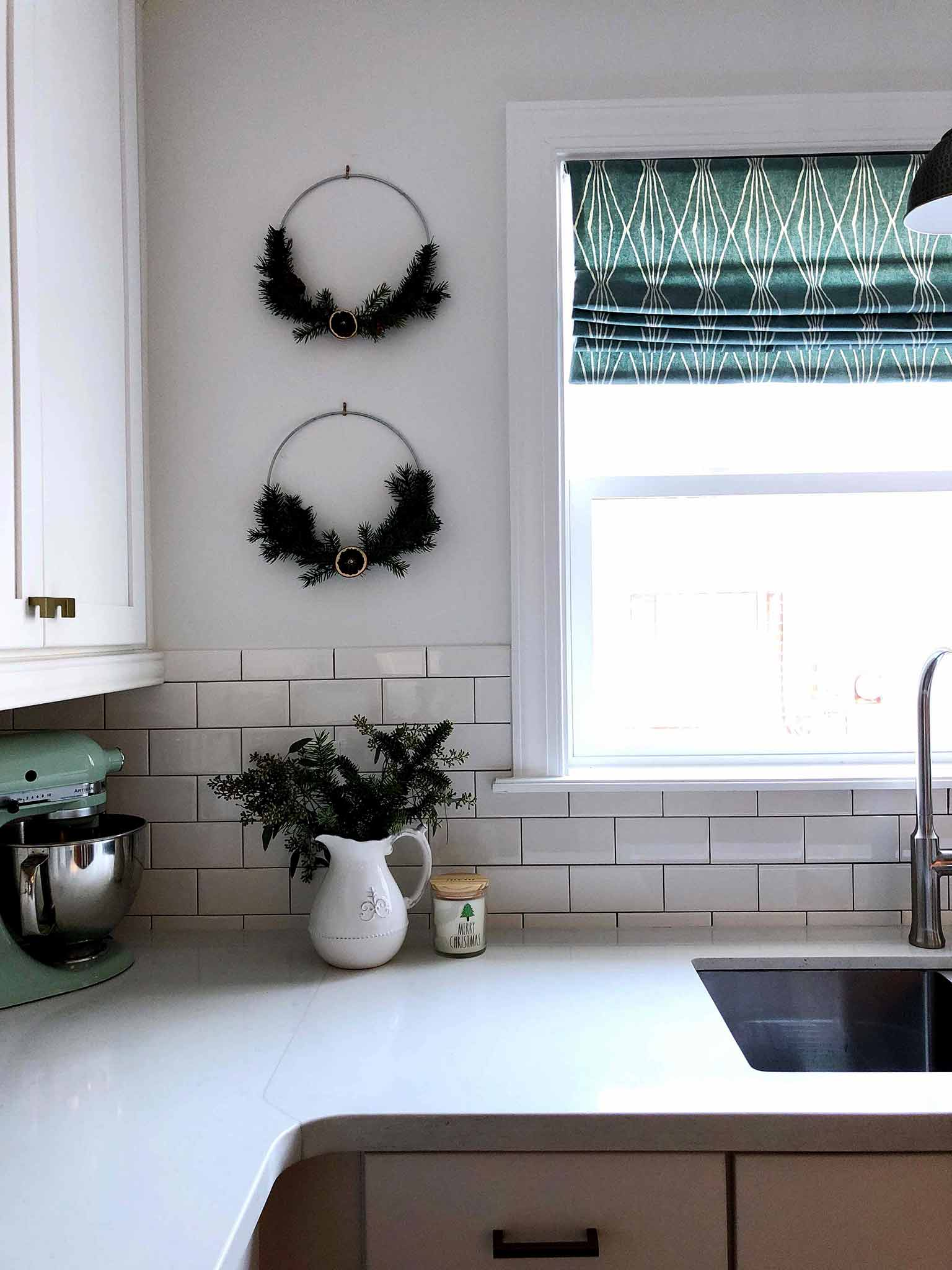 Kitchen decorated with hoop wreaths - Simple Yet Cozy Christmas Decor - That Homebird Life Blog #christmasdecor #christmasinspiration