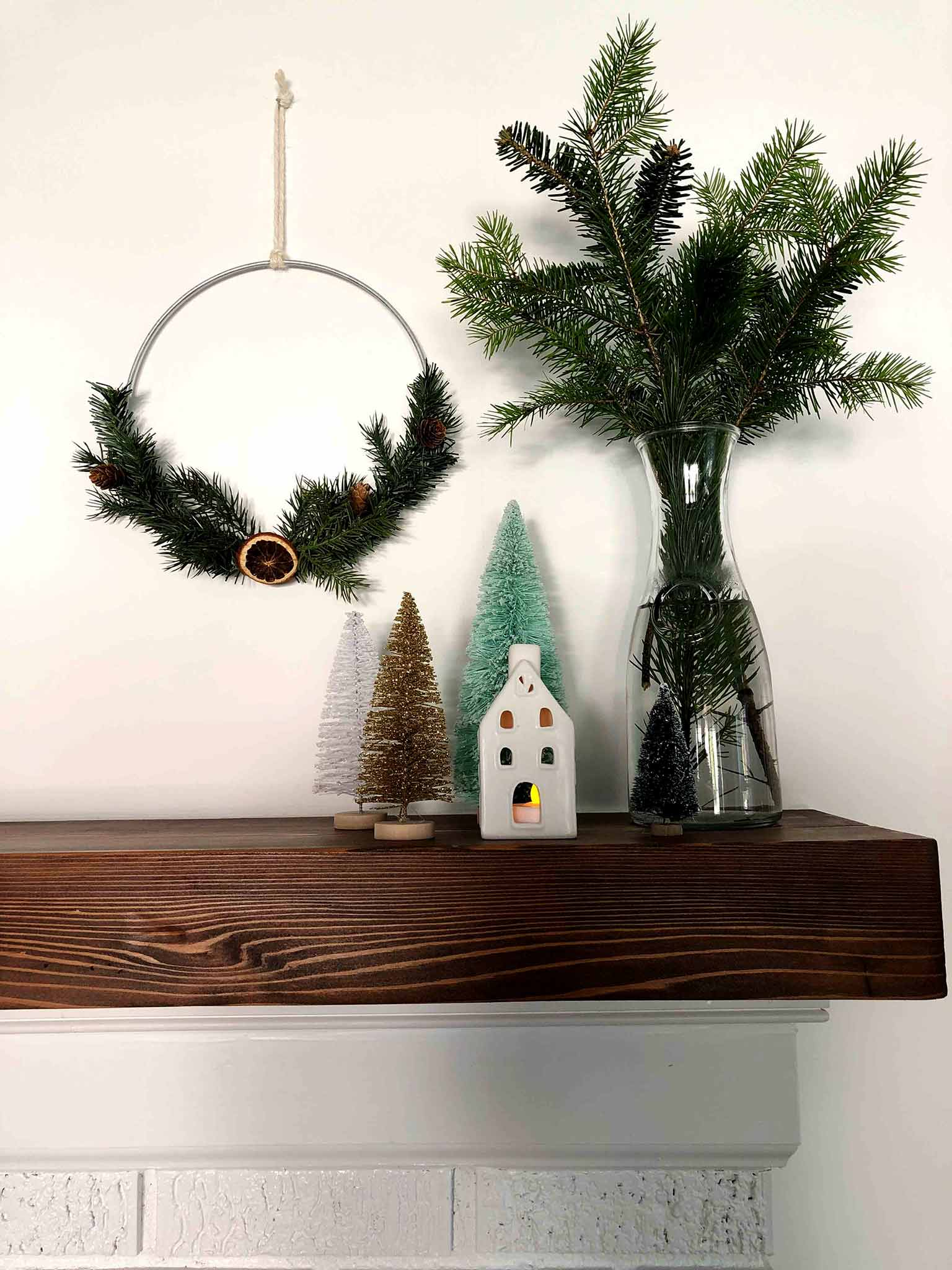 Mantel with hoop wreaths and bottle brush trees - Simple Yet Cozy Christmas Decor - That Homebird Life Blog #christmasdecor #christmasinspiration