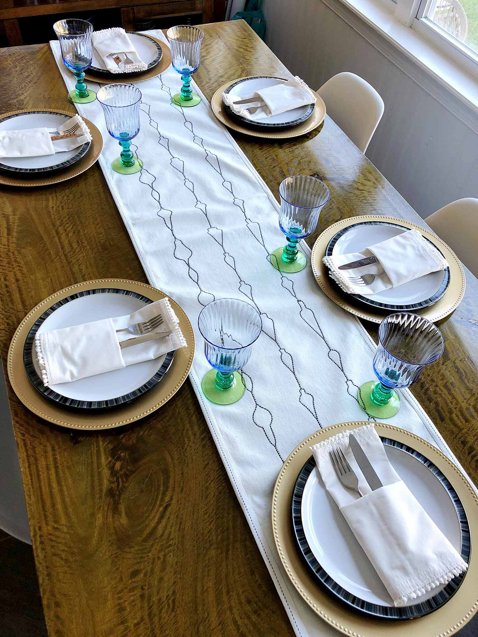 Adding dinnerware and glassware | How to Create a Beautiful Tablescape on a Budget | That Homebird Life Blog #christmasdecor #tablescape