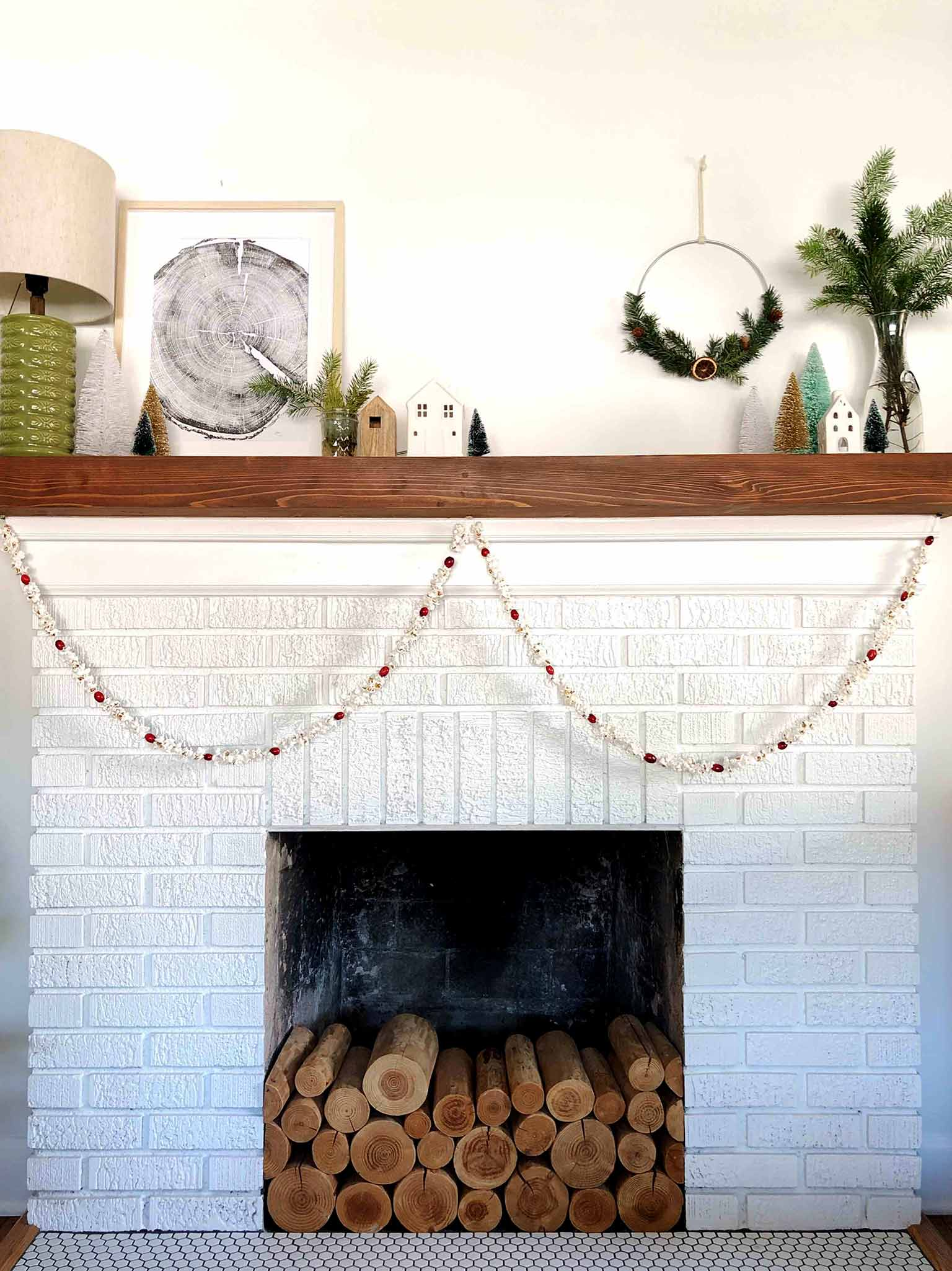 popcorn and cranberry garland on mantel