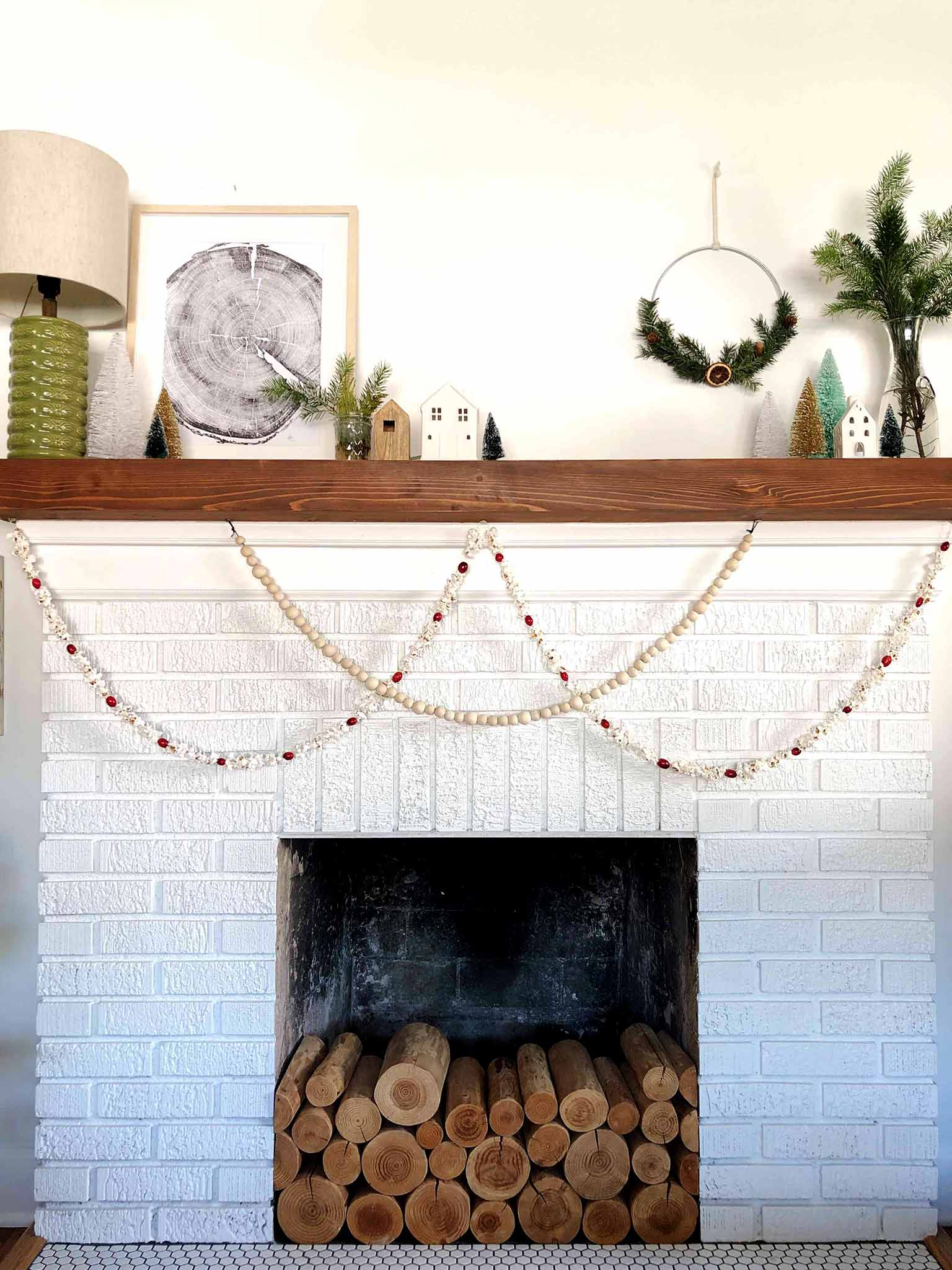 two garlands on a brick fireplace
