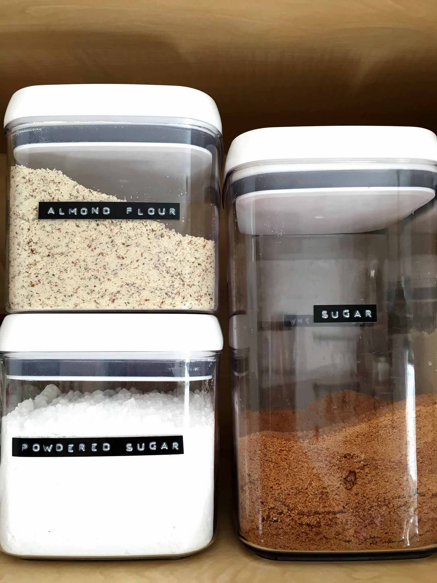Clear flip lid food storage in a pantry | 14 of My Favorite Products to Help You Organize What's Left After Decluttering | That Homebird Life Blog | #organization #organizationideas