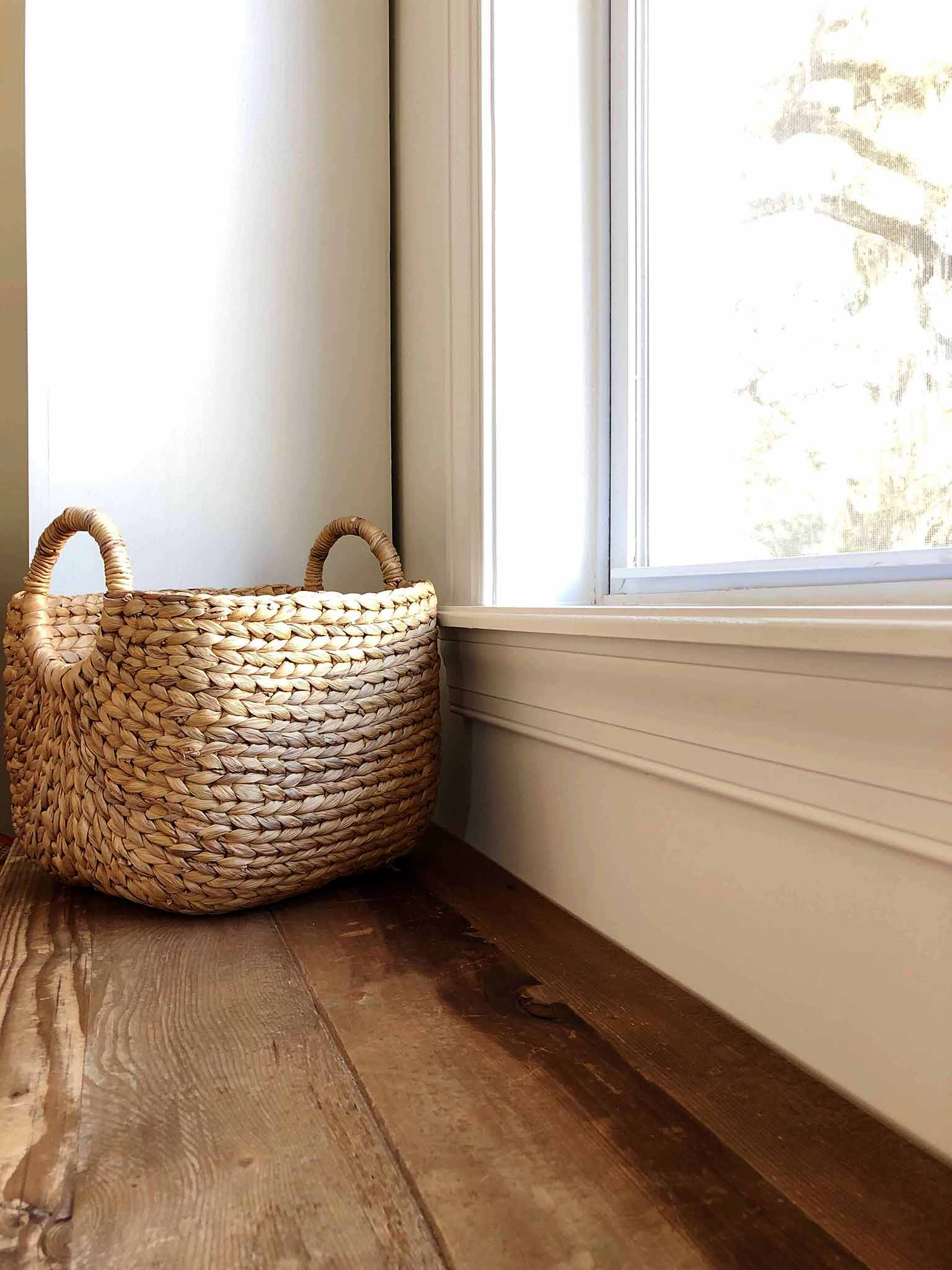 Basket on a window bench for toy storage