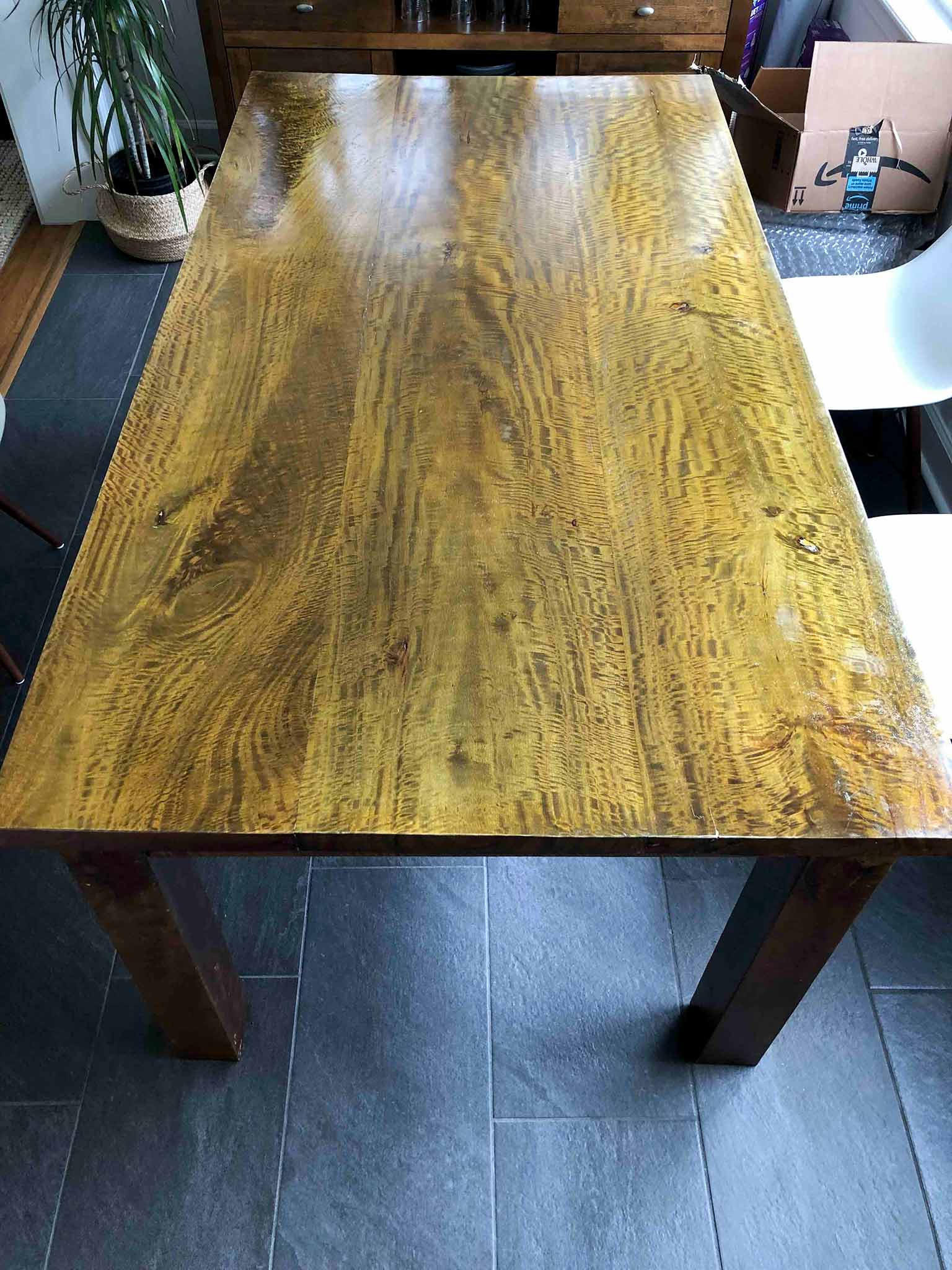 dark wood dining table before refinishing
