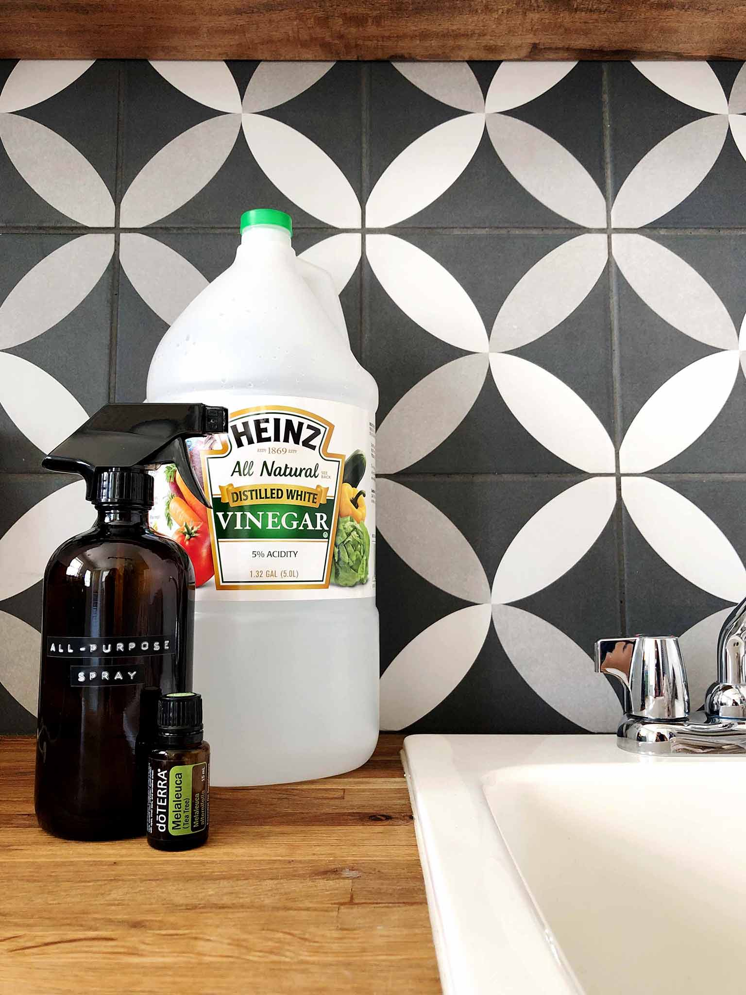 tile backsplash with vinegar, essential oil and cleaning spray