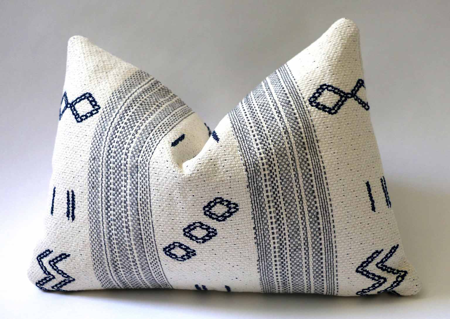 Blue and white patterned pillow