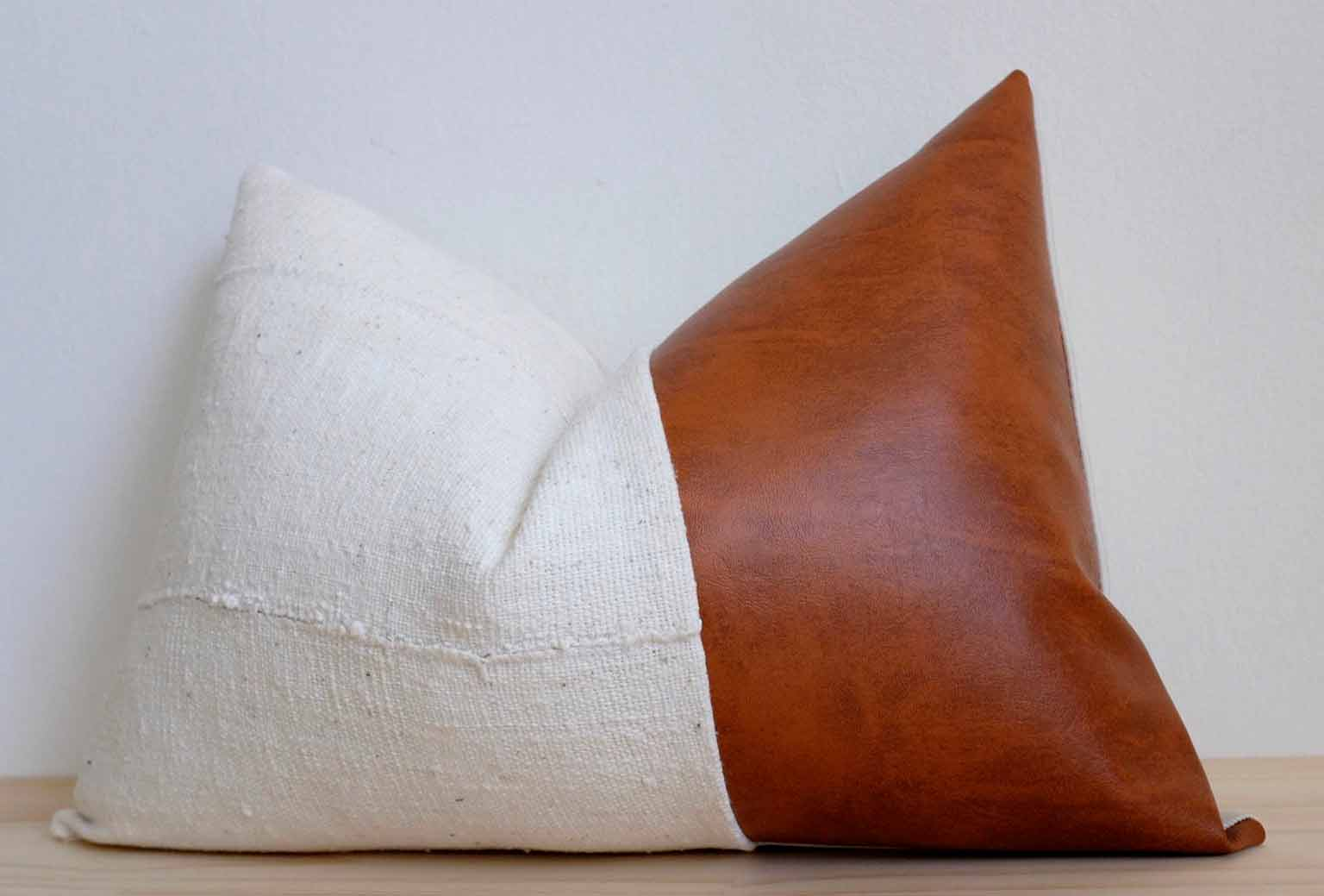 White mudcloth and leather pillow