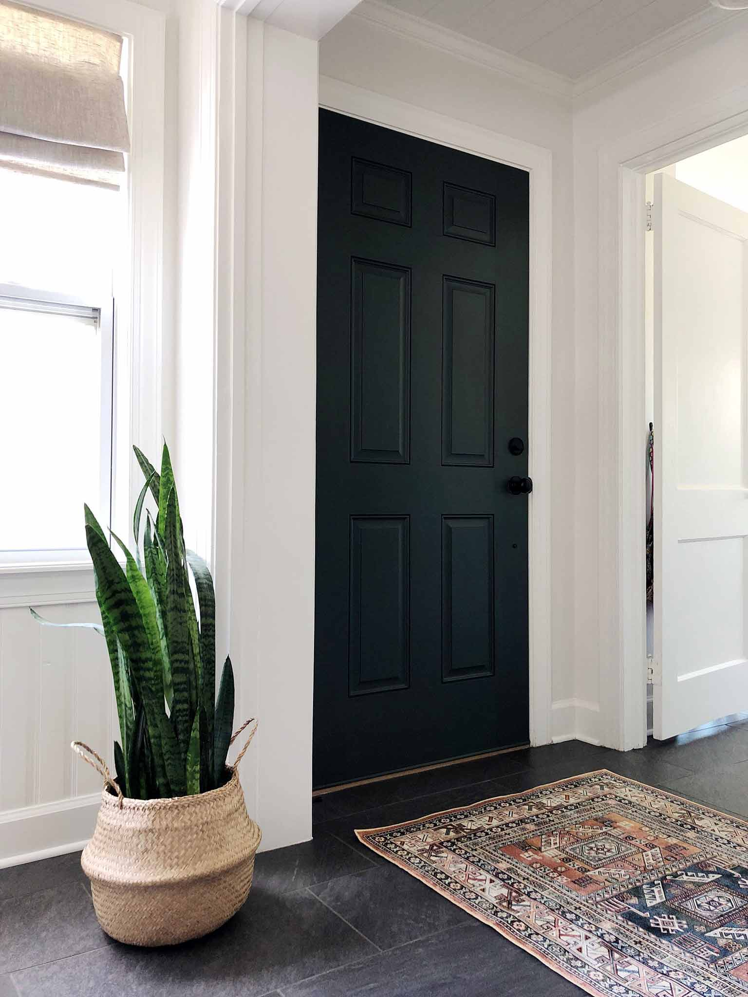 entryway with dark green door