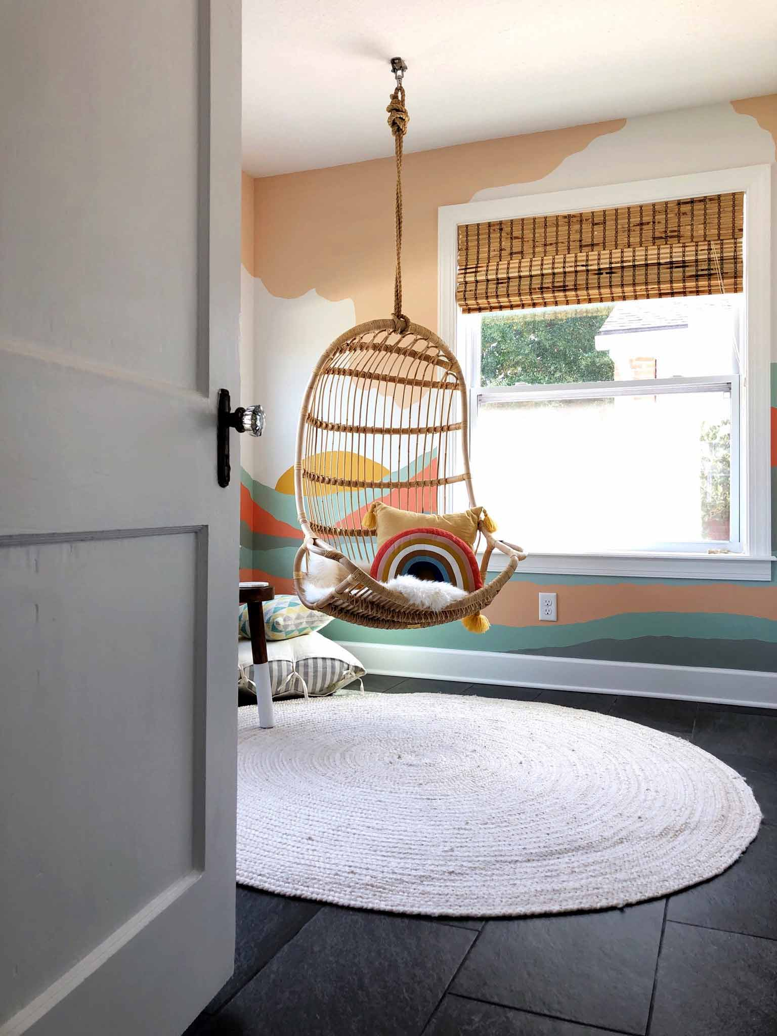 playroom with colorful mural and hanging chair