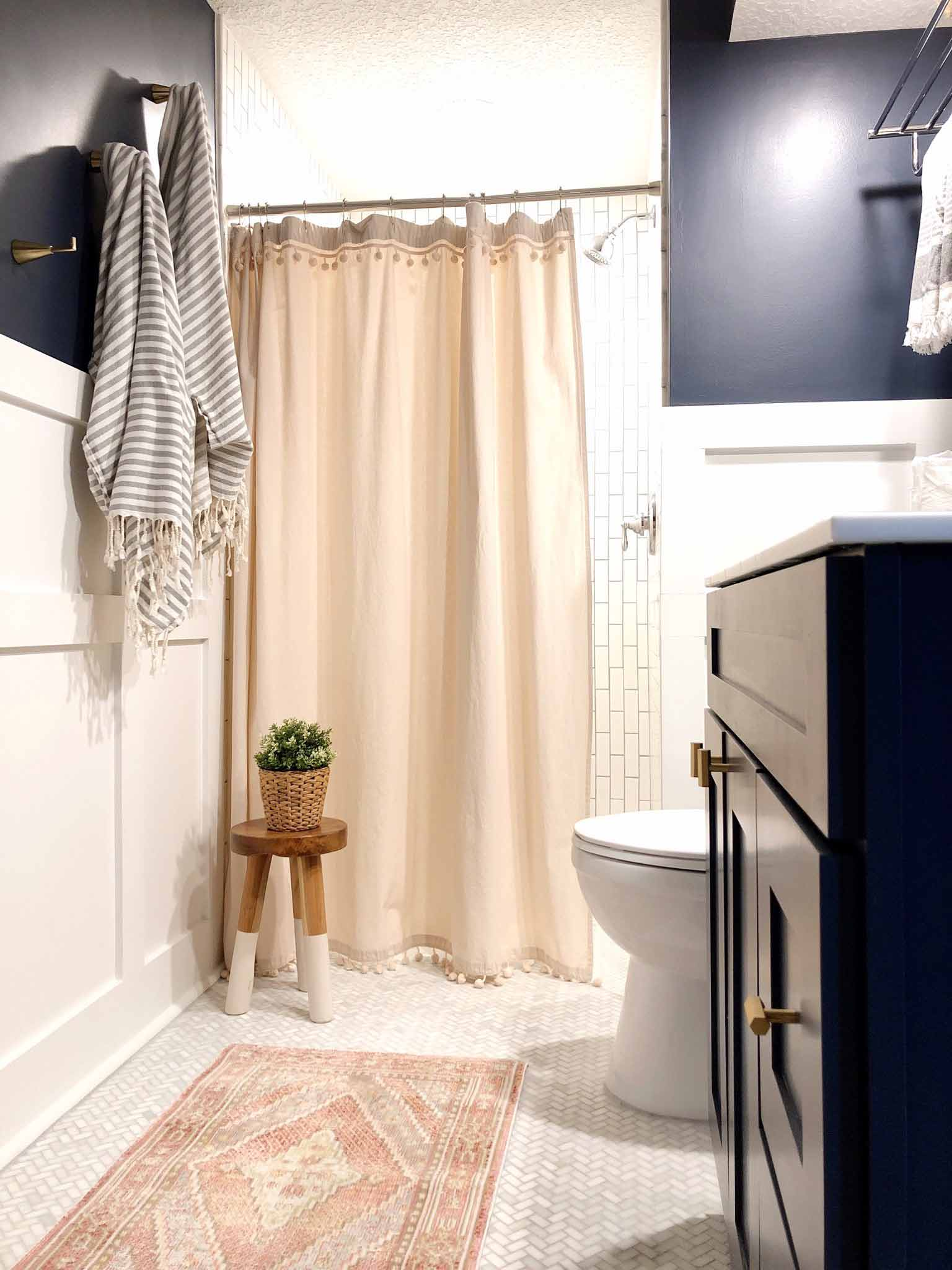 navy and pink bathroom with white tile