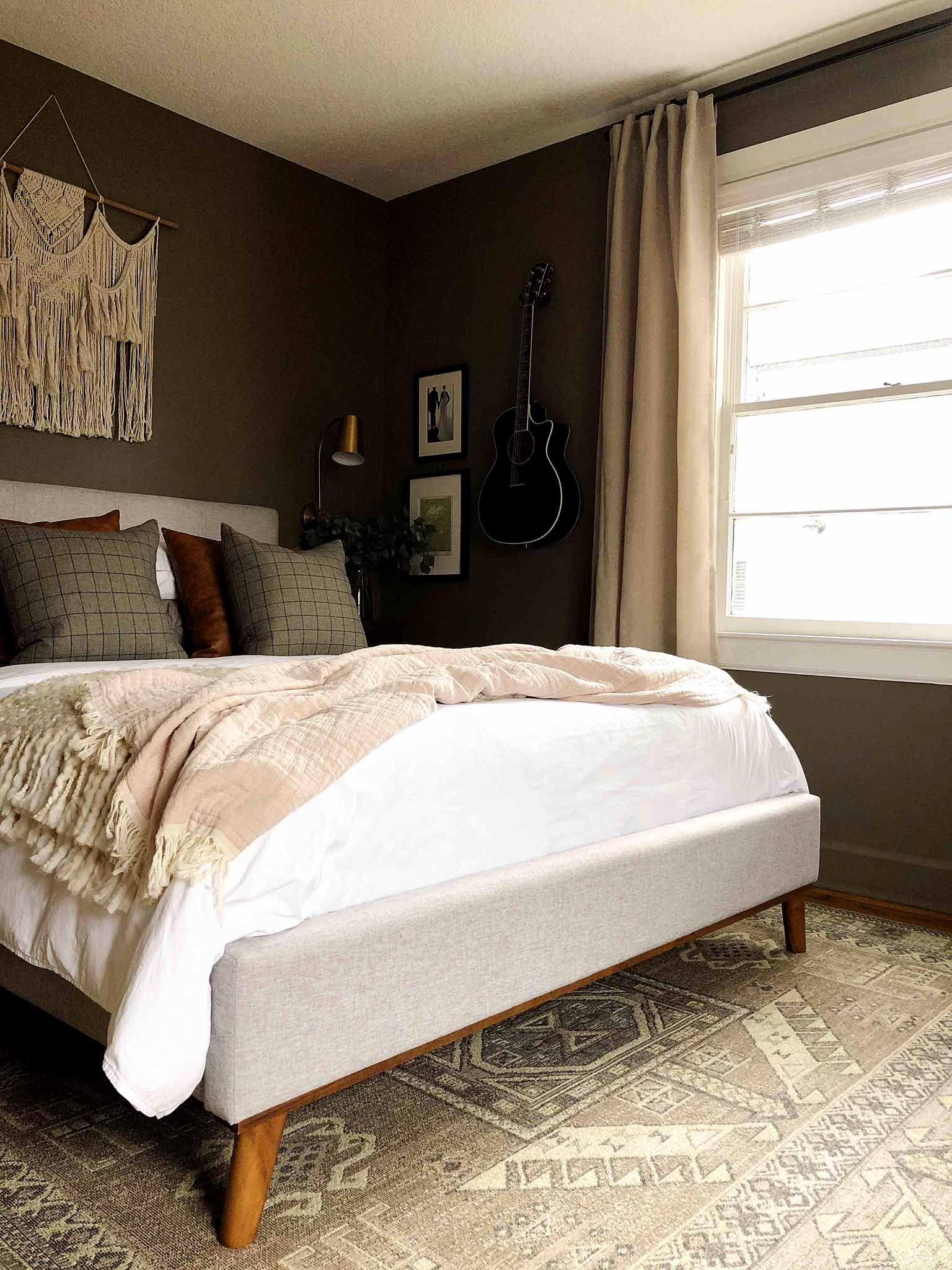 neutral master bedroom with upholstered bed