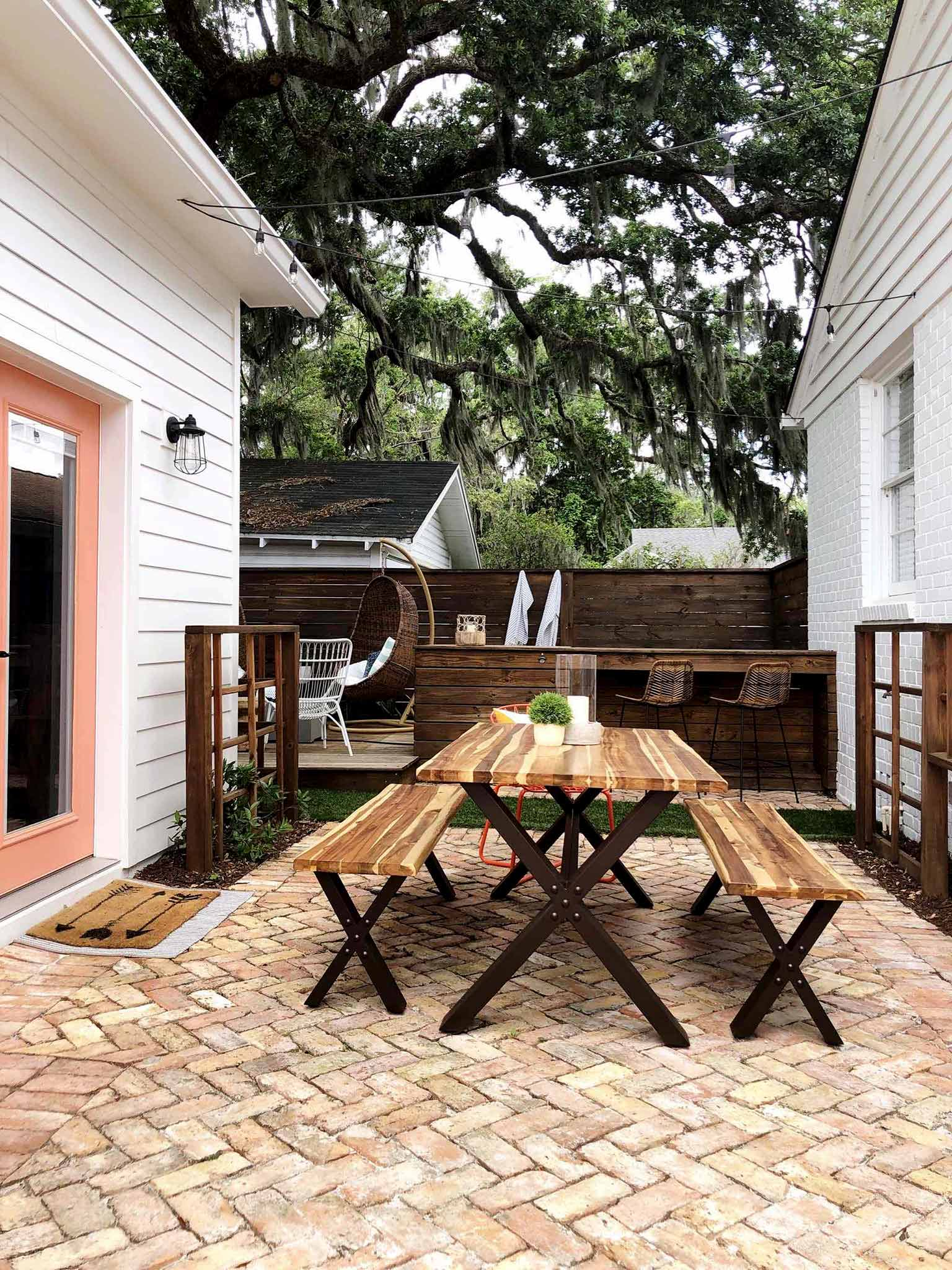 brick patio with table and benches