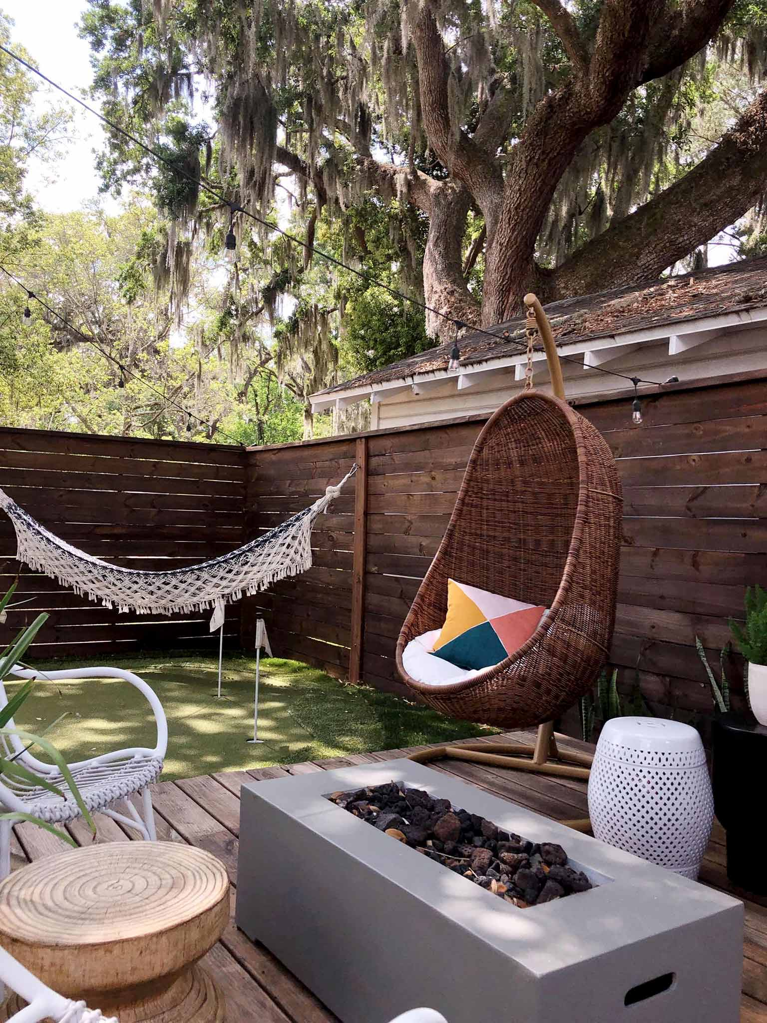 deck with hanging chairs and hammock