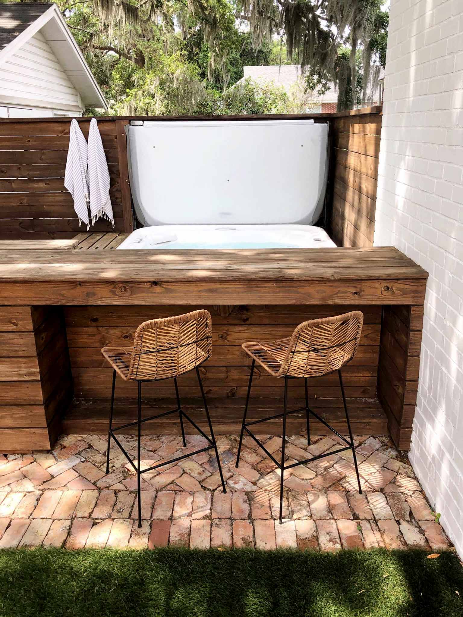 outdoor bar with bar stools and hot tub
