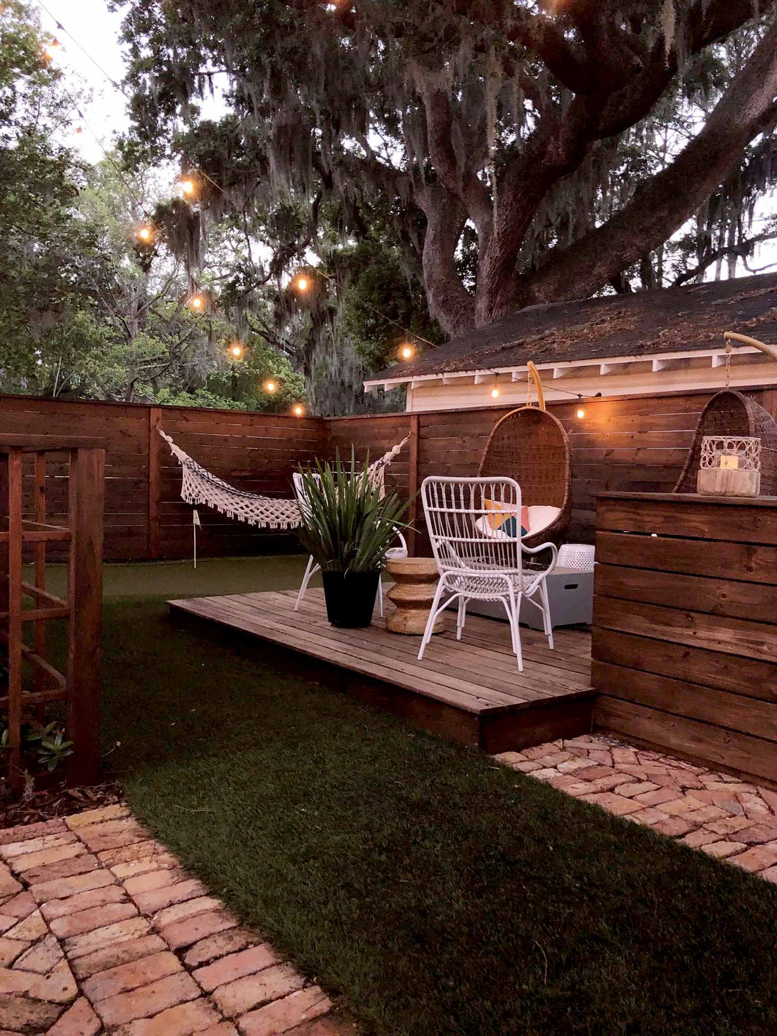 backyard deck under string lights