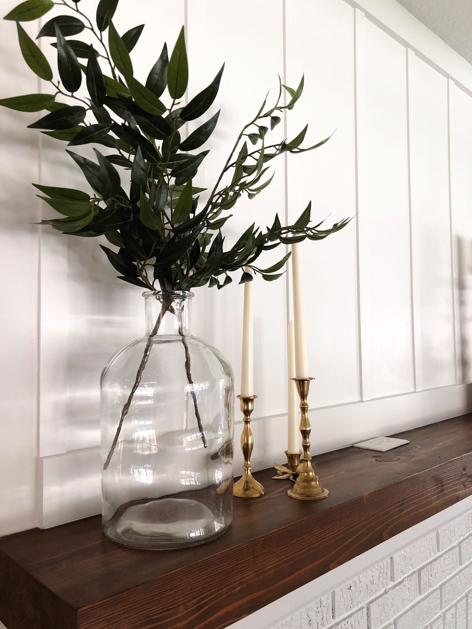 glass vase and brass candlesticks