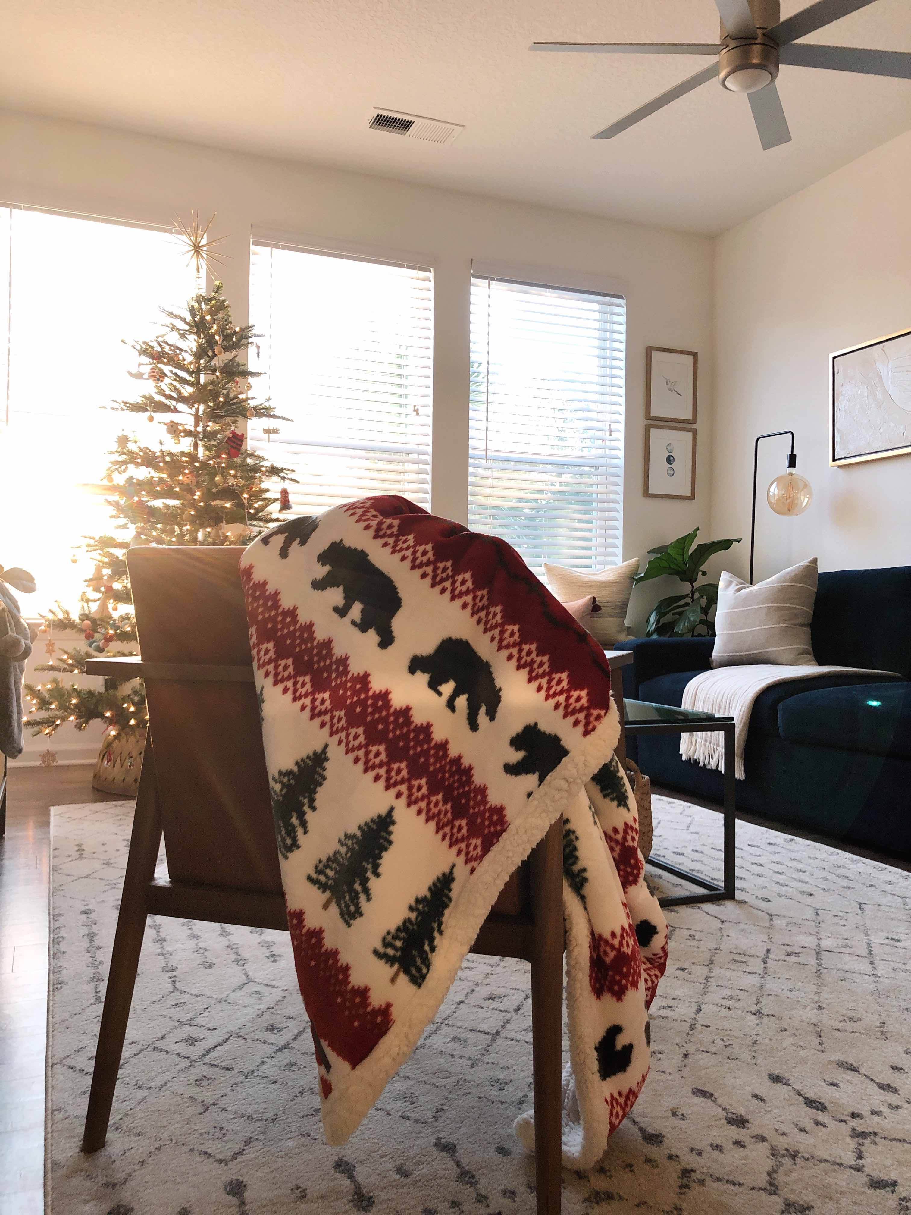 blanket on chair with christmas tree